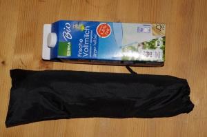 Packmaßvergleich zw. Milchkarton und Hocker